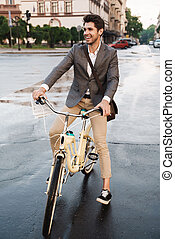 Business man outdoors on a bicycle