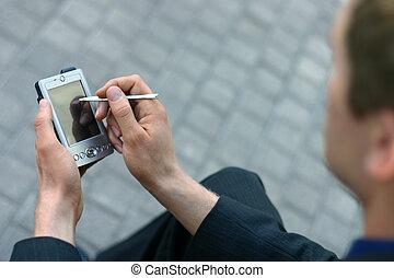 Business man pda - Business man using his PDA