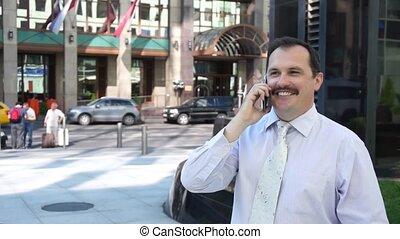 Business man phone speaking outdoor
