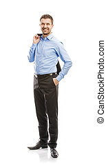Business man - Successful business man in suit is posing in...