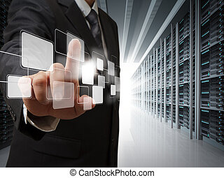 business man point virtual buttons in server room