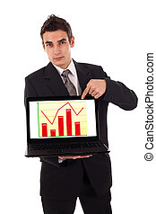 Business man pointing at a laptop computer with diagram