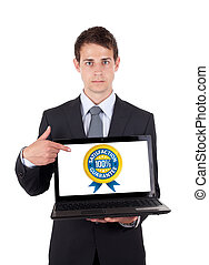 Business man pointing at a laptop computer