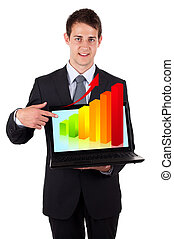Business man pointing at a laptop with graph