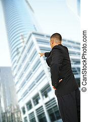 Business Man Pointing At Building
