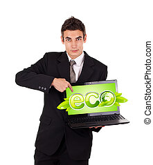 Business man pointing at eco laptop