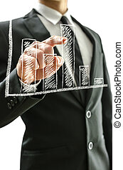 Business man pointing at graph