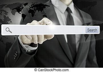 Business man pointing at search bar on virtual screen -...