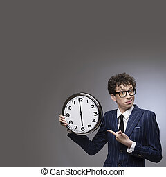 Business man pointing at time