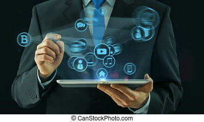 Business man pointing on big data technology network media concept tablet pad on black dark background
