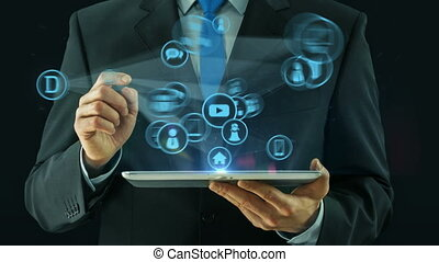 Business man pointing on digital media network concept tablet pad