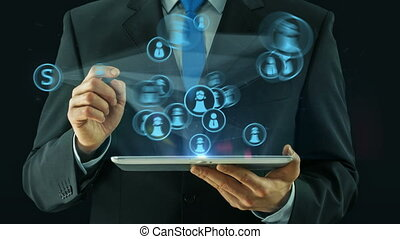 Business man pointing on social network concept tablet pad...
