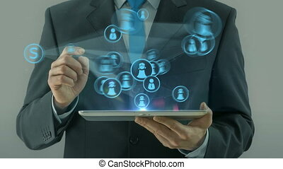 Business man pointing on social network concept tablet pad