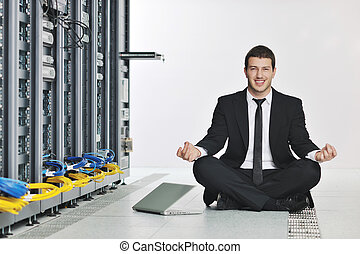 business man practice yoga at network server room - young...