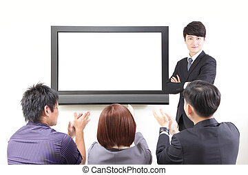 business man presentation to colleagues with TV