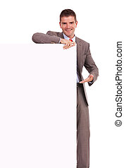 business man presenting blank board - Young business man...