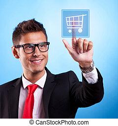 Business man pressing a shopping button