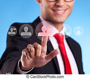 Business man pressing round social buttons