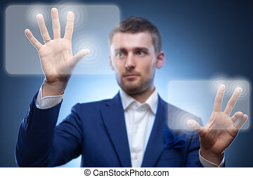 business man pressing touchscreen button