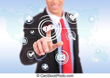 business man pushing a chat button ona futuristic interface