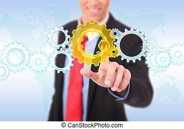 business man pushing a cog button