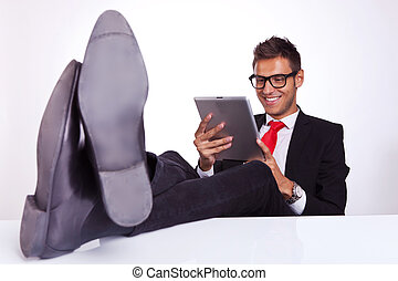 business man reading on his electronic tablet pad