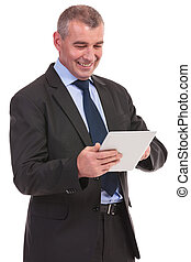 business man reading on his tablet