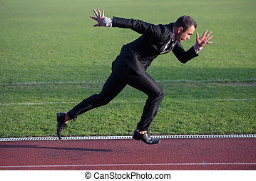 business man ready to sprint - business man in start...