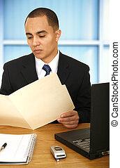 Business Man Reviewing Folder
