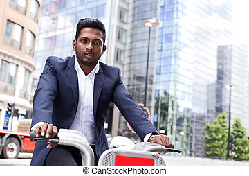 Business man riding a bike
