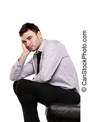 Business man sat looking upset isolated on white