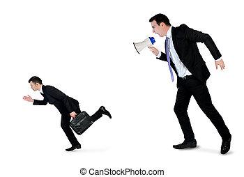 Business man screaming on megaphone