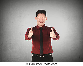 Business man show two thumbs up