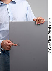 Business Man showing empty space white placard