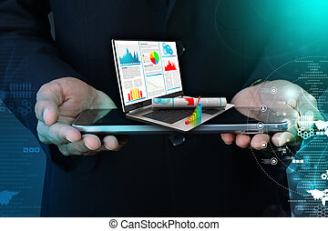 Business man showing financial report in laptop