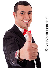 Business man showing his success with thumbs up