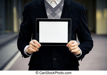Businessman holding and shows digital tablet pc with blank screen.