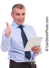 business man shows thumb up with tablet in hand
