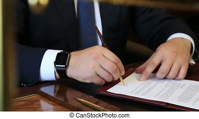 business man sign papers with apple watch at his hand