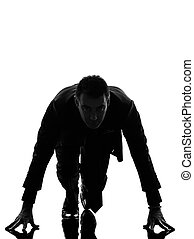 business man silhouette on starting block