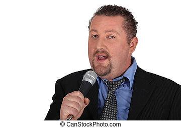 Business man singing karaoke