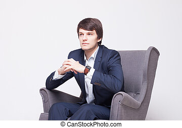 business man sits on chair over white background