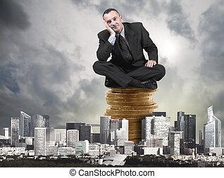 man sittin on money in the city