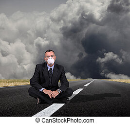 man sitting in a middle of the road