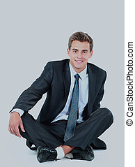 business man sitting isolated on a white background.