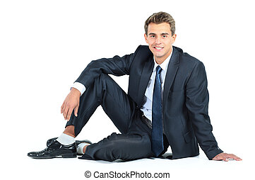 business man sitting isolated on a white background