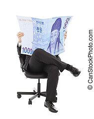Business man sitting on a chair with korea currency