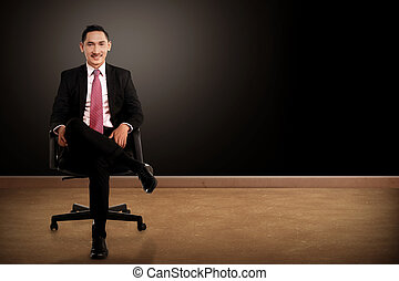 Business man sitting on the chair