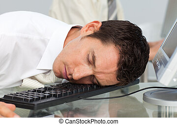 Business man sleeping at his desk