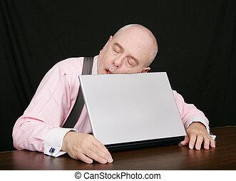 business man sleeping on his laptop - business man sleeping...